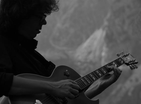 Man playing jazz music on guitar