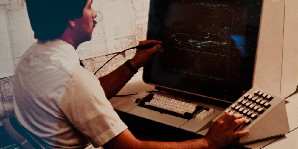 Man Operating a Vintage Computer